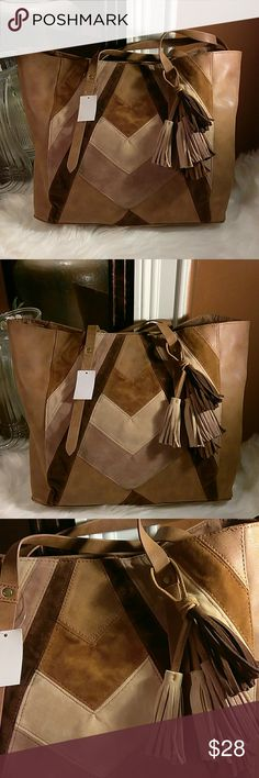 """Unique Tote This beauty features suede and leather like texture, single inside compartment, tassle, snap closure. Lightweight, easy to carry. Measures 17w x 12h x 6 at the bottom with an 8"""" handle drop. A fun piece to have. T-Shirt & Jeans Bags Totes"""