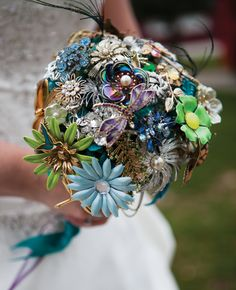 Broach Bouquet! They can take on so many different looks! And they last forever and include family heirlooms!