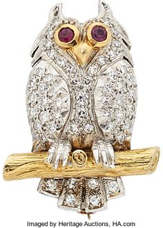 Diamond, Ruby, Gold Brooch.  The owl brooch features single-cut Diamonds weighing a total of approximately 0.60 carat, accented by round-cut Rubies weighing a total of approximately 0.10 carat, set in 18k white and yellow Gold. Gross weight 14.70 grams. Dimensions: 1-1/8 inches x 7/8 inch.