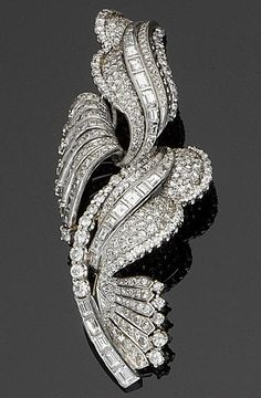 A diamond spray brooch, circa 1965.  Set with graduating ribbons of brilliant, baguette and single-cut diamonds, diamonds approximately 7.00 carats total, French assay marks. (=)