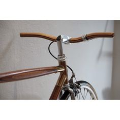 Wooden Handle Bar  Add a touch of sportiness and elegance to your bicycle with this wooden handlebar.  Laminated wooden handle bar : step bar type Dimension : Wide 450 mm, Diameter 23 mm  Colour : natural wood colour  Material : mixed Teak, walnut, oak  veneer