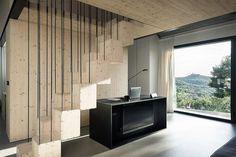 House by Dekleva Gregoric Arhitekti, situated in Slovenian the region of Karst (stairs/bookshelves)