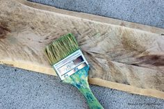tutorial - how to on painting pallet wood ... chippy brush, paint -- a little of  this, a little of that, dump colors together -- stain, old rag... etc etc pics and walk through. go read :)
