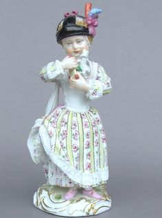 Meissen Model: F 90        Description: Girl With Toy Lamb   Modeled By: Michel Victor Acier ca. 1770   Mark: F 90 (may not be correct)       Painter Number:    Height: 6 in - 15.2 cm  Notes: Marcolini Mark 1774 to 1817
