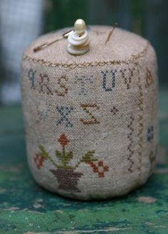 Cross stitch pinkeep drum.