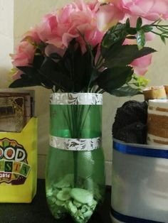 Diy vase : Cut out a soda bottle and decorate with washi tape  Put in a few shells from the beach and place flowers.