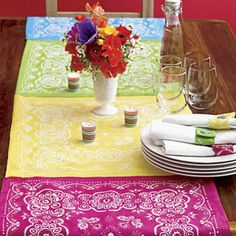 Bandanna Table RunnerProvided By:    Add a cheerful touch to the summer table with this patchwork-style runner. Line up enough bandannas to fit the length of a table, leaving some overhang, and stitch together. To back the runner, cut an old cotton tablecloth (any light-colored one will do) to match its width and length. Sew together along the edges or attach with iron-on bonding. Stick with the theme and serve up one of our top rib recipes!photo credit: Wendell T. Webber