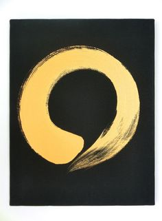"""Enso Gold on Black Canvas - Ensō (円相) is a Japanese word meaning """"circle"""" and a concept strongly associated with Zen. Ensō is one of the most common subjects of Japanese calligraphy even though it is a symbol and not a character. The ensō symbolizes absolute enlightenment, strength, elegance, the Universe, and the void. It is characterised by a minimalism born of Japanese aesthetics. As an """"expression of the moment,"""" it is often considered a form of minimalist expressionist art. The circle…"""