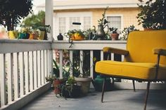 love the yellow chair and the welcoming porch
