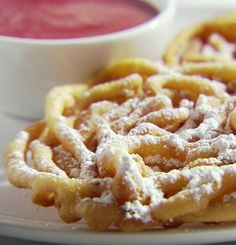 Recipe for Funnel Cakes with Strawberry Sauce - These are so easy to make and everyone will love you for the nice surprise at your next get together or just a fun dessert to cheer up the kids!!