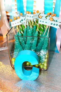 Under the Sea Rock Candy. I used these classic treats as part of a party favor. Again though, how great for a desert table? The color is perfect and really encompasses the under the sea theme. Feel free to add a food label: Coral Reef