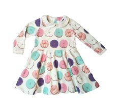 We are so excited about this new twirl dress, it is a comfortable and stylish addition to any little girls wardrobe. It is made out of the softest organic cotton knit fabric with our donut design. It has stretch to it so it is easy for little babies and toddlers to be active in. This dress has a sprinkle peter pan collar, a keyhole back and a button closure.All of the seams have been professionally serged for durability. Machine wash inside out delicate in cool or cold water. La...