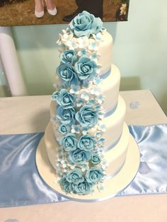 Baby blue roses complete this anniversary cake.