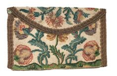 The beadwork on this purse dates from the eighteenth century, yet the envelope shape suggests it was made up much later, in the twentieth century. Circa 1900-1929.
