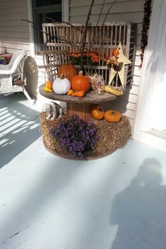 Wooden spool decorated for Fall