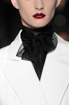 Yves St Laurent  The black sheer collar, on the white thick suit  creates a sophisticated and elegant look!