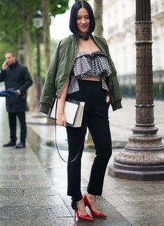 green bomber jacket, ruffled blouse, red heels, love.