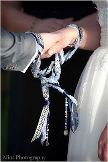 Handfasting ceremony with colored cords.