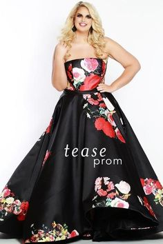 3570303b54d Look like a movie star in a black satin plus size ball gown with bold  floral print. Ideal for Prom 2018 or any formal.