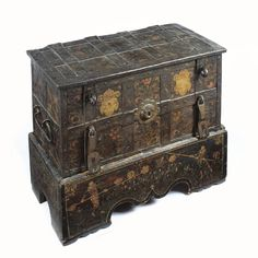 A South German painted iron strong box 17th century painted throughout with flowers and shields, the central lockplate in the form of a flower head, upon wood base painted  with halberdiers. height 30 1/4 in.; width 37 1/2 in.; depth 18 3/4 in