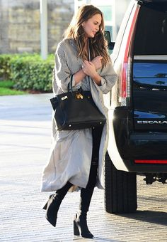 Chrissy Teigen's latest skinny jean outfit idea is so chic and effortless. See the one piece you need here.