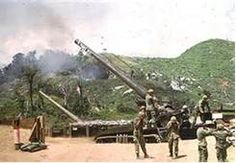 This looks like Camp Carroll. My unit, Echo/2/4 was just below here on a knoll protecting these guns from the NVA in the surrounding hills. Feb. 1968 Vietnam War - 175 Howitzer.
