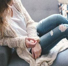 Comfy outfit. White v-neck, cardigan, and ripped blue jeans