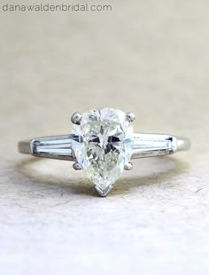 Pear Shaped Diamond Engagement Ring in platinum with diamond baguettes by Dana Walden Bridal, NYC