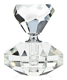 A girl's best friend indeed! This diamond-shaped perfume bottle features a multifaceted construction for a truly shimmering display.