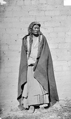 Shoshoni Man in Native Dress Near Brick Wall 1878 by William Henry Jackson (1843-1942)