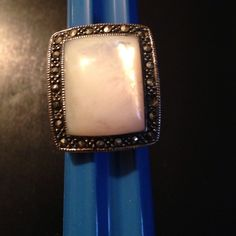 Sterling silver, mother-of-pearl ring size 8 1/2 This sterling silver ring is stamped 925. There is a mother of pearl stone that measures 3/4 of an inch. Around the mother of pearl there is a marcasite border Jewelry Rings