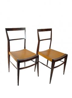 A pair of elegant side chairs in the style of Gio Ponti. Original vinyl seat.   Italy, c.1950