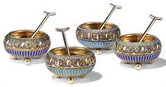 TWO PAIRS OF SMALL RUSSIAN SILVER-GILT AND CLOISONNE ENAMEL SALTS, EACH WITH SILVER SALT SPOON
