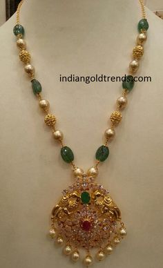Latest Indian Gold and Diamond Jewellery Designs: emerald Pearl gold beads with peacock pendant