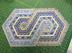 Great design for a quilt or table runner using 60 degree triangles.