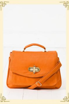 A classic golden turn-lock closure adorns the messenger flap on this classically shaped bag. $48
