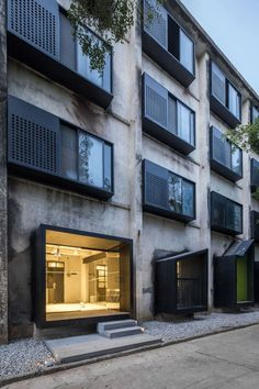 (29) O-office Architects · Youth Hotel of iD Town ramen erker schrijnwerk inkom gevel zwart geperforeerd | architected | Pinterest / minimal / architecture / concrete / glass