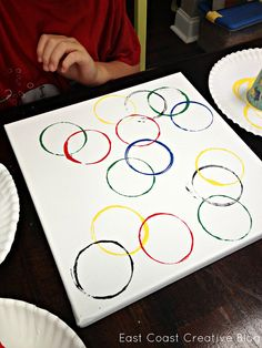 East Coast Creative: Olympic Crafts for Kids {2012 Olympic Games} a cup or toilet paper roll and paint. dip roll or cup into paint and put on paper