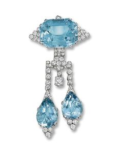 AN ART DECO AQUAMARINE AND DIAMOND BROOCH, BY CARTIER The octagonal-shaped aquamarine flanked by six diamond collets suspending two pear-shaped aquamarine drops with old and circular-cut diamond connecting links, circa 1930, 8.8 cm long, with French assay marks for platinum Signed Cartier