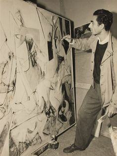 Chilean born abstract expressionist painter Roberto Sebastián Antonio (1911 - 2002) painting in his Rome art studio,1950.