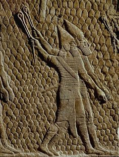 Assyrian slingers attacking the Judean  fortified town of Lachish (battle 701 BCE).  Part of a relief from the palace of Sennacherib  at Niniveh, Mesopotamia (Iraq).  See also 08-02-03/52