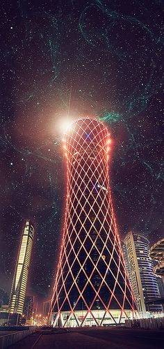 Tornado Tower - Doha, Qatar.  The animated lighting system can cause  the structure to appear that it swirls like a tornado in the desert.  A commercial building, it contains offices, restaurants and shops.