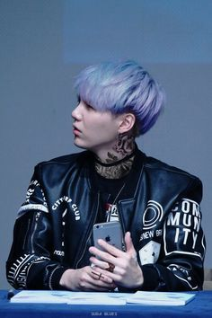 Tattooed Min Suga with purple hair