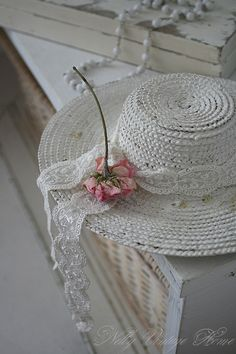 Shabby Chic hat.  Take an old straw hat, spray-paint it with white Flower spray to give it a even matt finish, let it dry and decorate with strips of lace and ribbons and add a silk rose or to to finish it off.  Let it rest on your bed on chair to give the decor that extra bit of touch.
