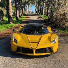 Ferrari LaFerrari Aperta painted in Giallo Tristrato w/ Nero central stripes Photo taken by: @gregb.23 on Instagram Owned by: @gregb.23 on Instagram