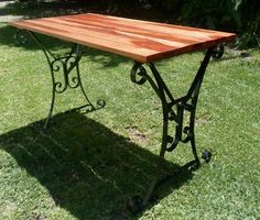 powder coated wrought iron table with African Teakwood top. Perfect for the patio! By The White Rabbit Forge