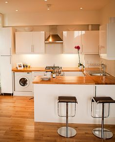 Some of my design work - contemporary white kitchen offset with wood floors and worktop.