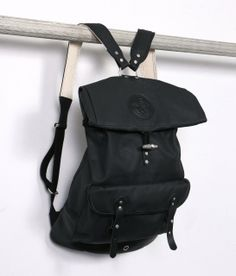 Slick, sexy, and stylish, Stighlorgan's canvas rolltop backpack is just showing off by also being weather resistant!
