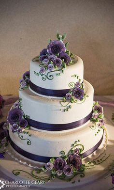 wedding cakes. I like the flower arrangements and vine look on this one. of course, with normal frosting. :)