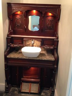 Antique pump organ becomes a bathroom vanity by replacing keyboard with marble.  The pedals control the water.